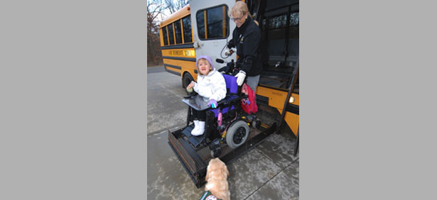 Special Ed bus driver and little girl