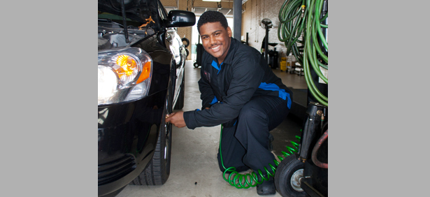 A KTC student working on car tires