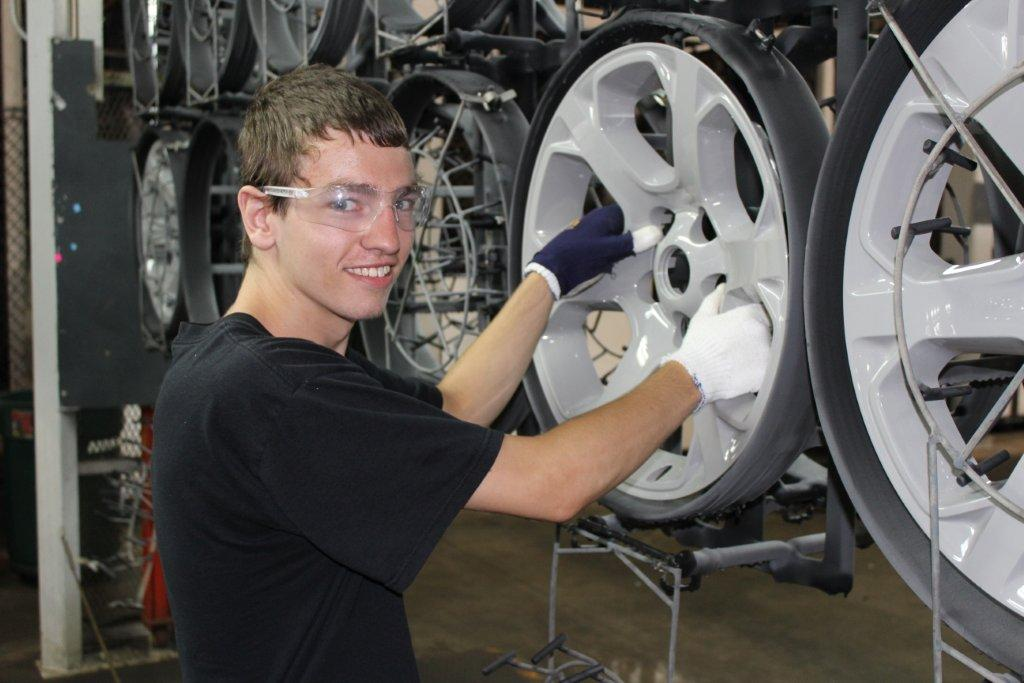 KTC Automotive student working on changing tires