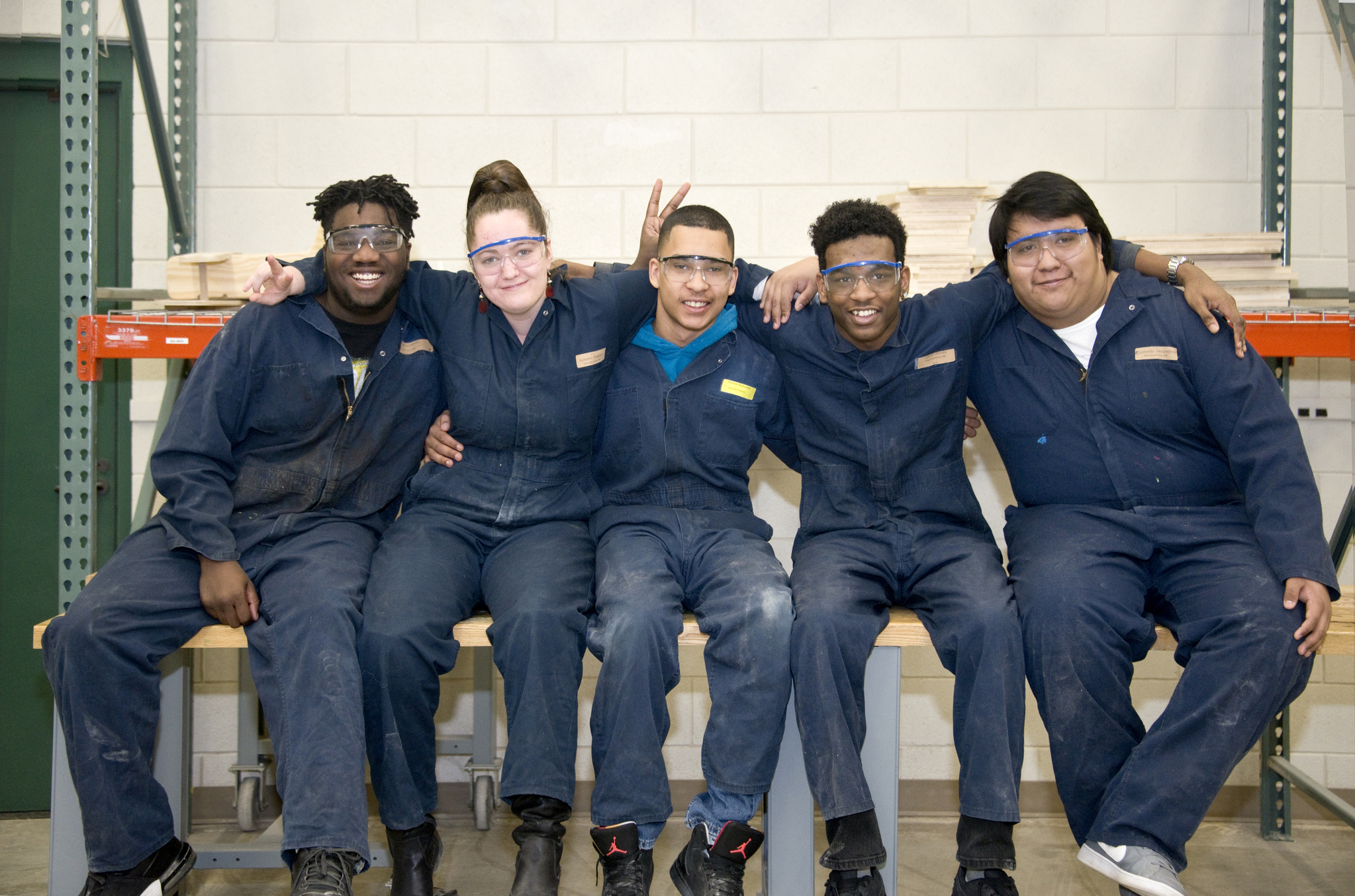 Automotive students sitting on bench