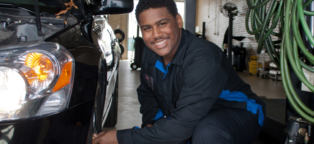 KTC Automotive student working on car