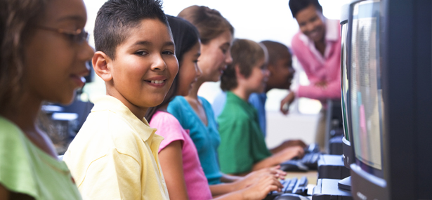middle school students working at computers web