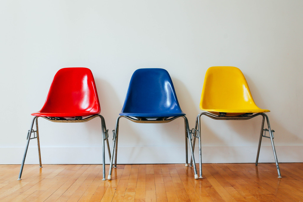 row of chairs - one is read, another is blue and the last is yellow