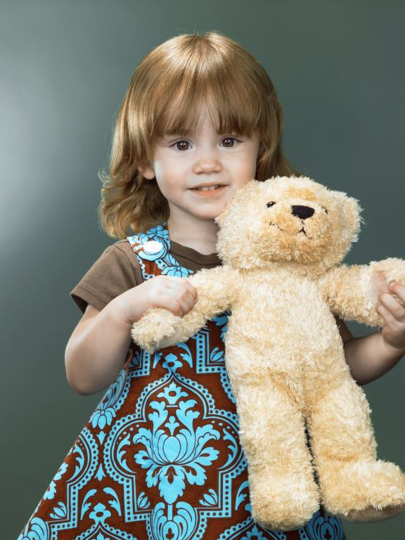 girl holding a bear cub